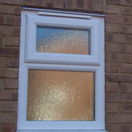 uPVC white window with a top opener