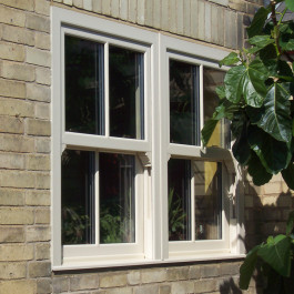 Close up of a cream sliding sash window