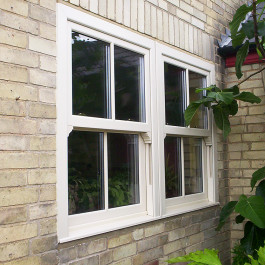 A cream coloured sash window