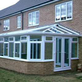 white conservatories with bricks