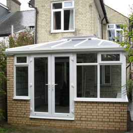 white conservatories built into bricks