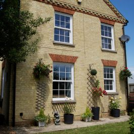uPVC sliding sash windows on the back of a property in Chittering, Cambridgeshire. Installed by Elglaze