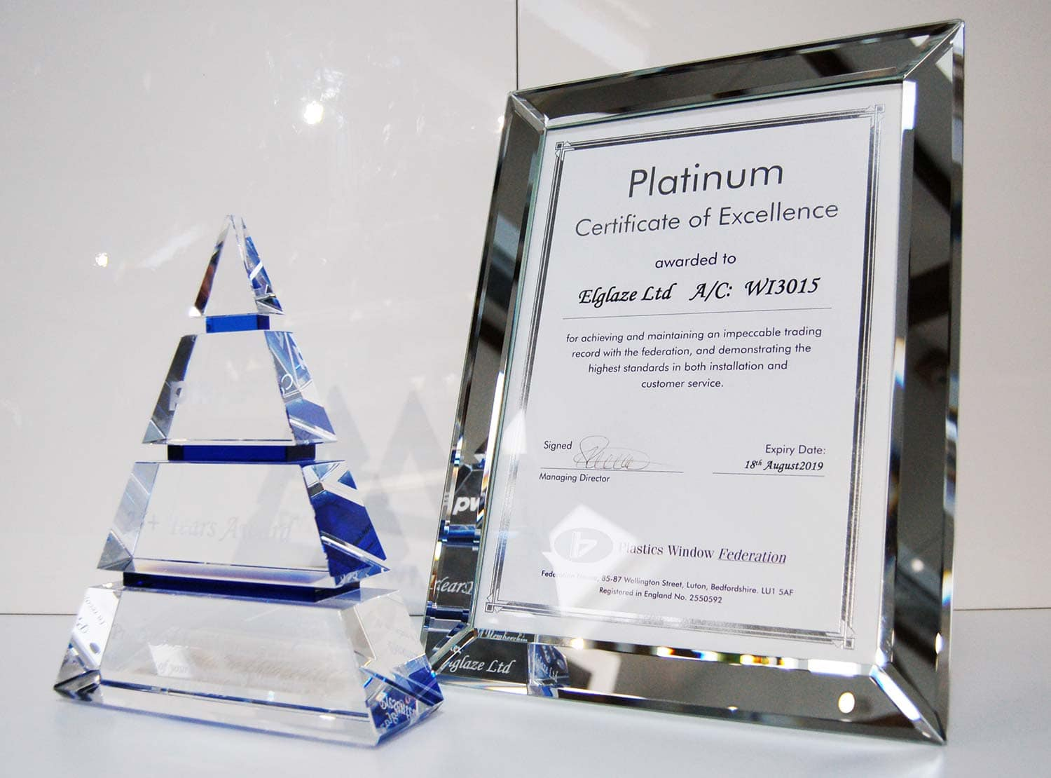 Platinum certificate of excellence and trophy awarded to Elglaze by the Plastics Window Federation