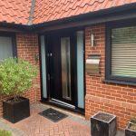 Black composite door and Anthracite grey casement windows