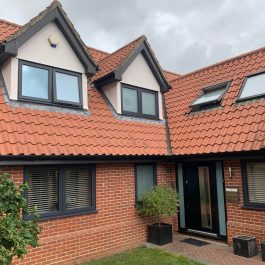 grey casement windows black composite door and velux windows