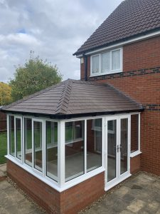 Equinox roof conservatory with brown tiles